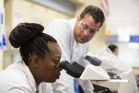 Valencia College biotech student using microscope