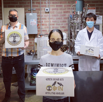 Laney biomfanufacturing students holding DIYBIO kits - photo credit Doug Bruce