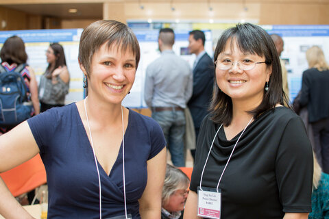 Two women members of the Collaborative at an event