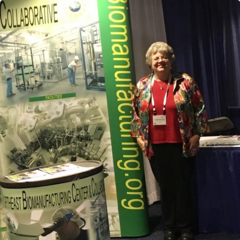 Linda Rehfuss staffing the booth at the ATE PI conference